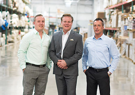 Ryan Ulfig, Dan Ulfig and Jim Judd in Master Craft's Michigan warehouse.